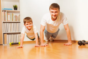Photo of boy and dad exercising