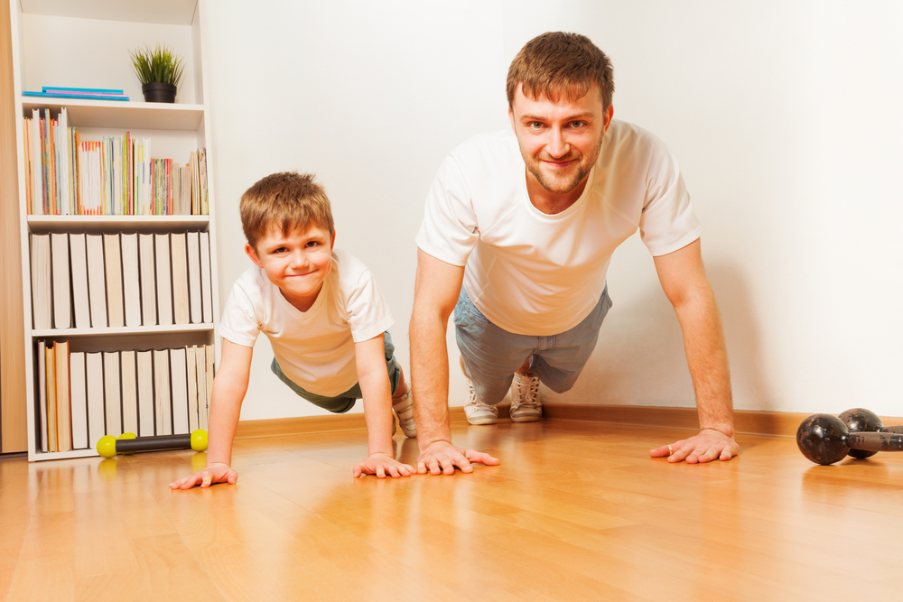 boy and dad doing pushups