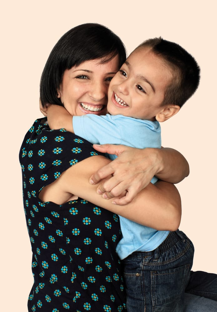 photo of little boy hugging mom